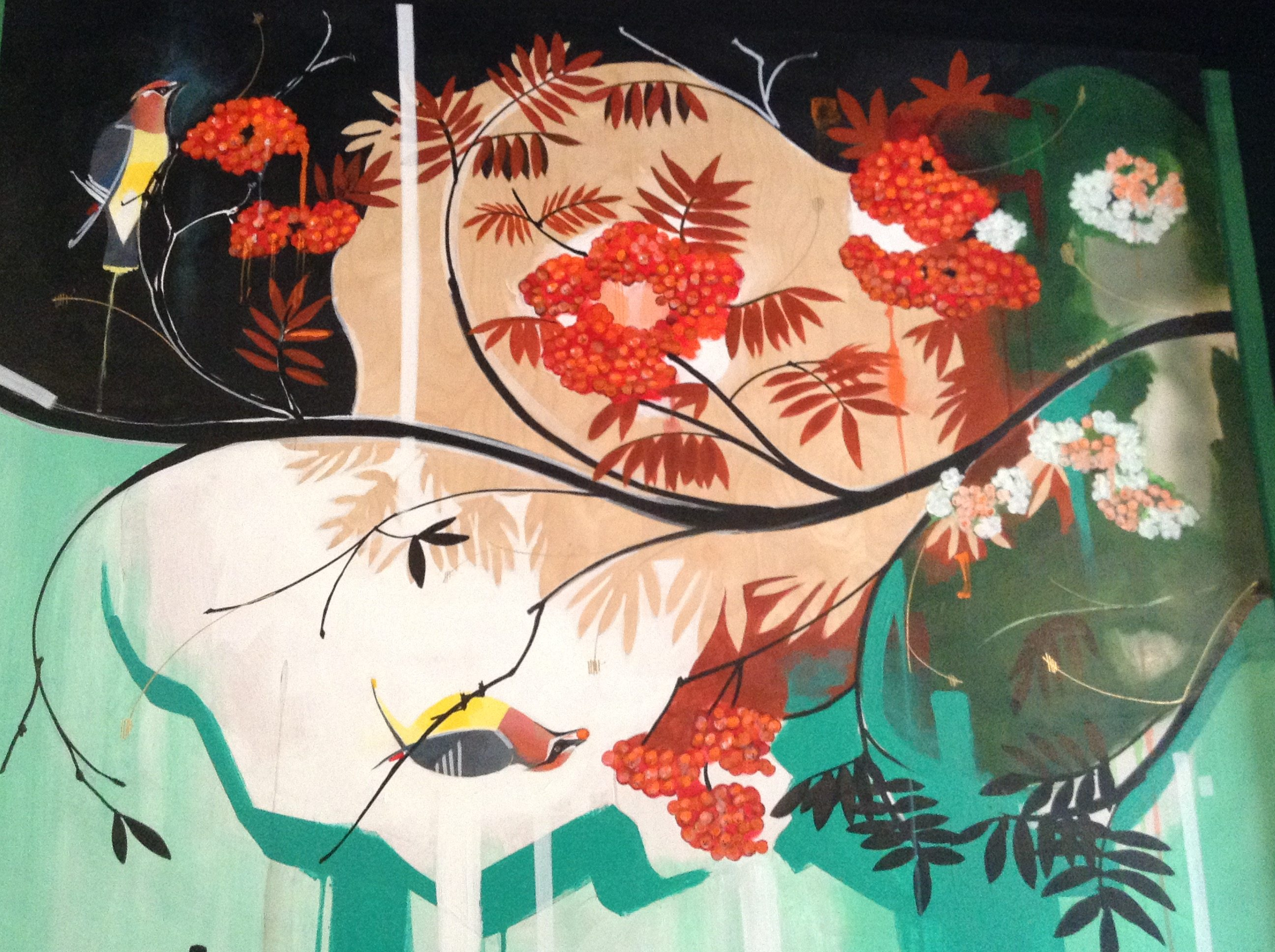 In one panel of the extended mural, the branches of the restaurant's namesake rowan tree play host to colourful waxwings.