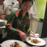 Stadtlander's wife, Nobuyo works by his side in the kitchen. She is plating the roast pork with potato dumplings and garden vegetables