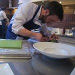 Chef Seth Gabrielse slices and plates tiny cubes of ramp royale