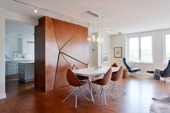 To create this open and sunny great room, Langlois removed a wall, which originally ran parallel to the windows, because it cut off light to the living and dining rooms. The divider is a functional piece of artwork that gives some separation to the kitchen space.