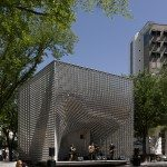 "More than an open-air performance venue, ""The Cube"" also acts as projection screen, shelter and sculptural object. The skin is composed of 20,000 hollow aluminum pieces.  5468796 Architecture Inc. Photo: James Brittain Photography"