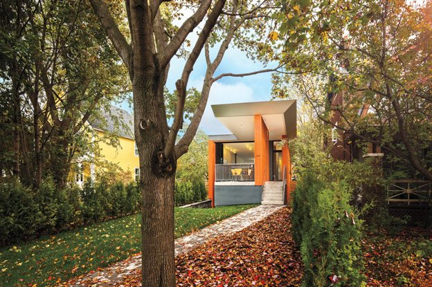 The Dutch heritage of homeowner Jolanda Turley inspired the cheery orange on the exterior. The family wanted their home to be bright both on the outside and within. Photography by PhotoluxStudio.com - Christian Lalonde