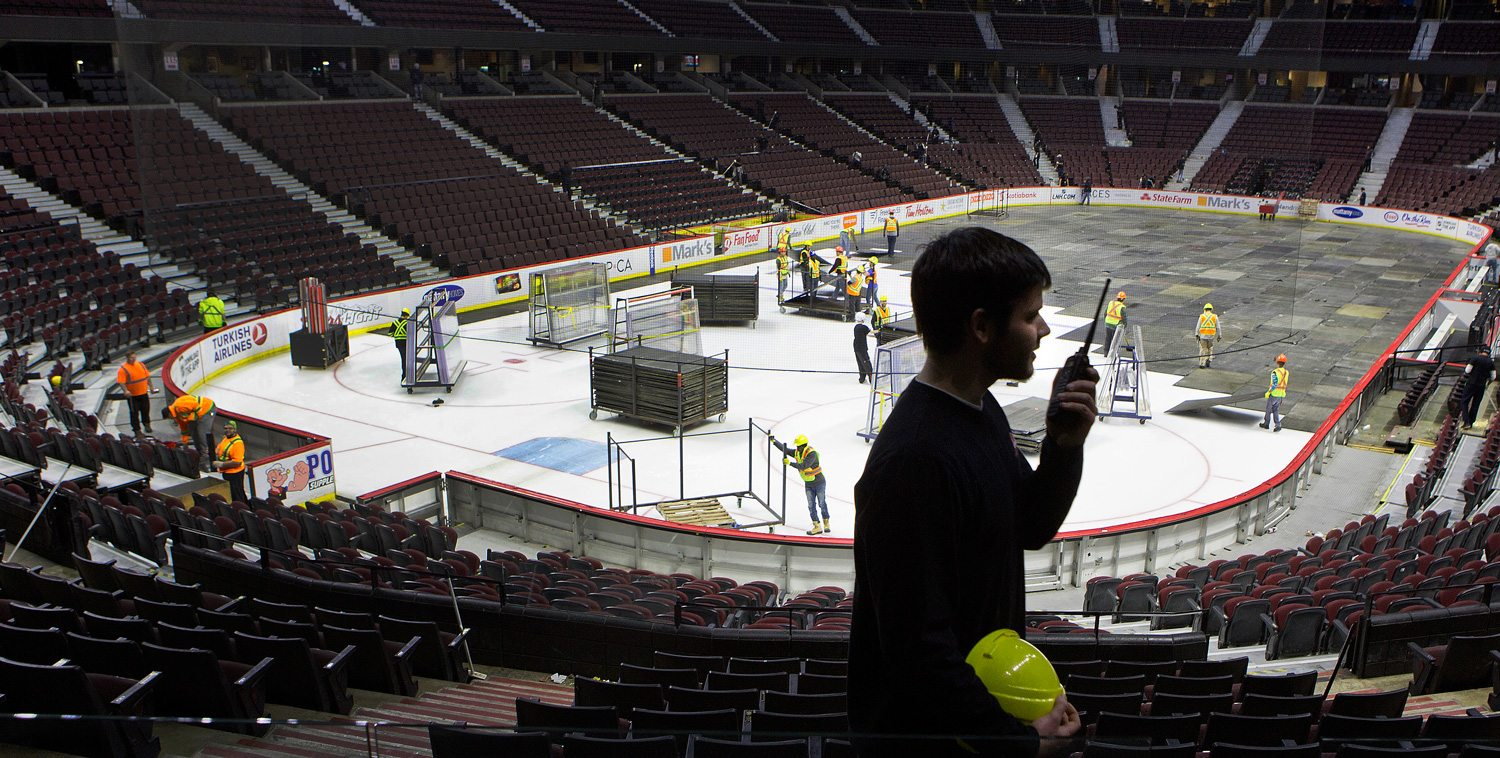 Steve Love works to set up the Canadian Tire Centre at night for the next day's events. Photo: Bill Grimshaw