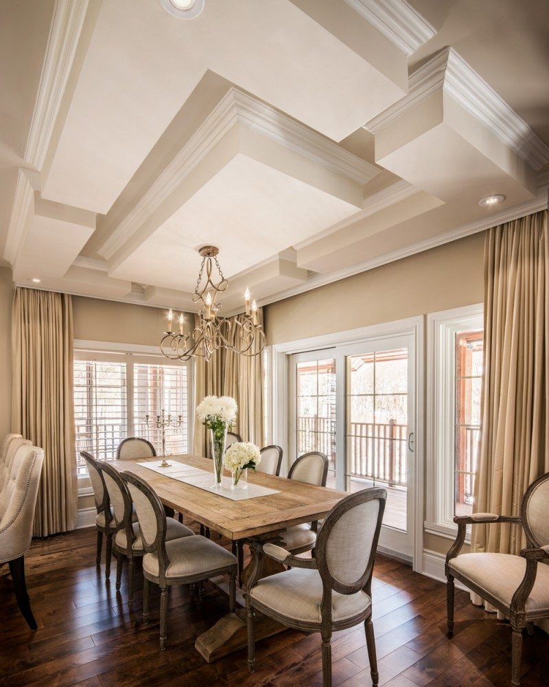 Decorated in a classic soft palette of powdery beiges, the warm and inviting dining room boasts balconies on two sides. Photo: Christiane Lalonde, Photolux Studio