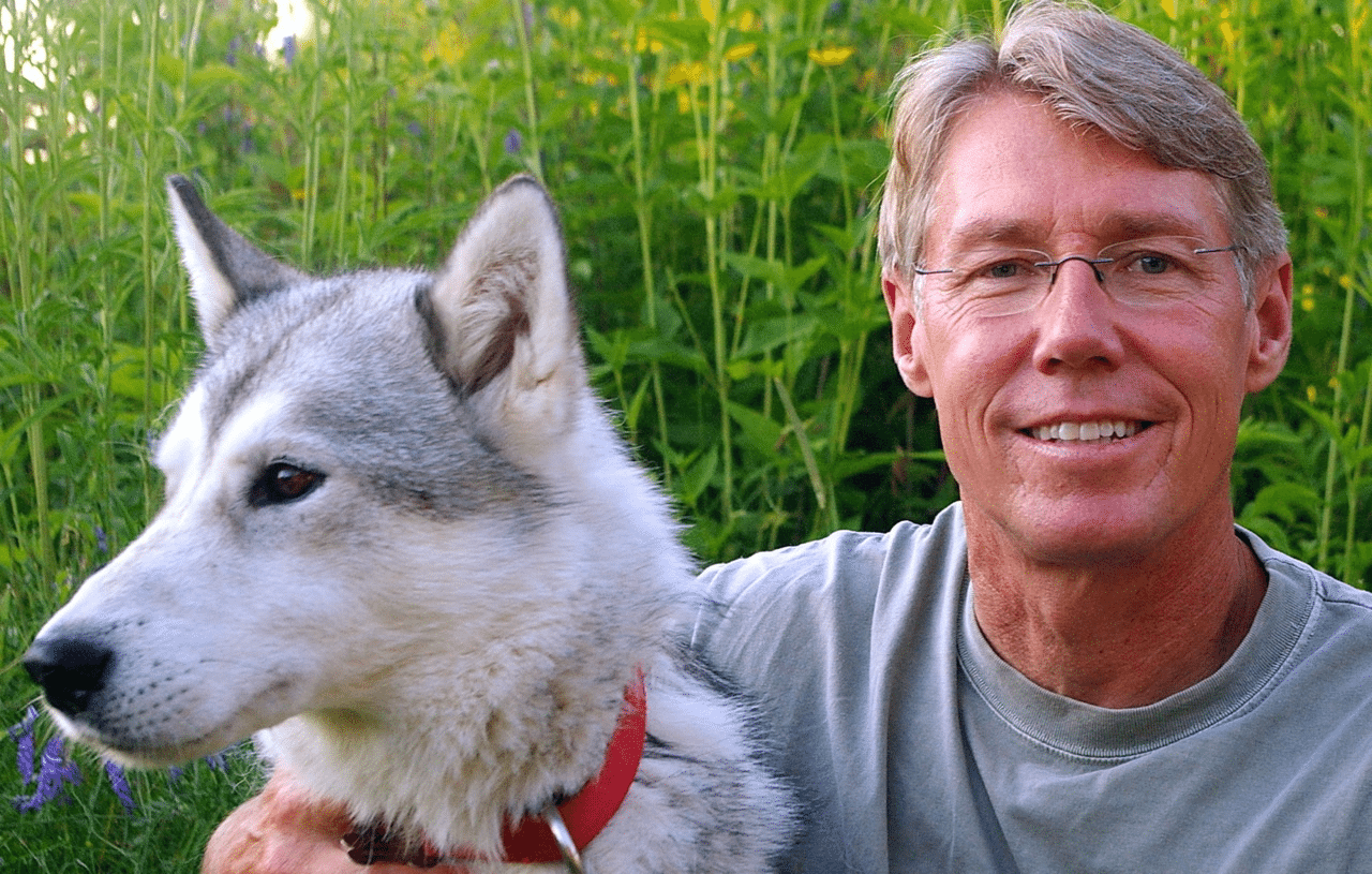 Professor Tim Pychyl, with canine friend Domi, says it is possible to conquer your procrastination. Photo by Beth Rohr.