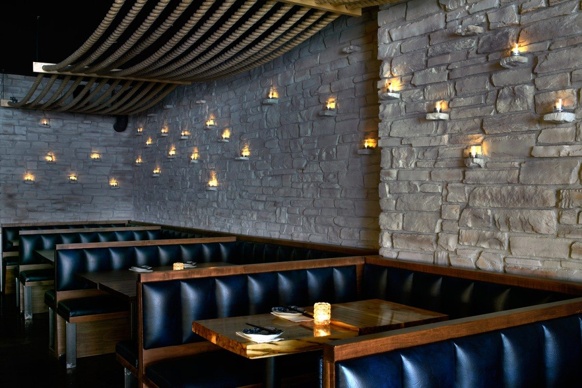Along the exposed stone wall, 99 tea lights twinkle. Photo: Gordon King