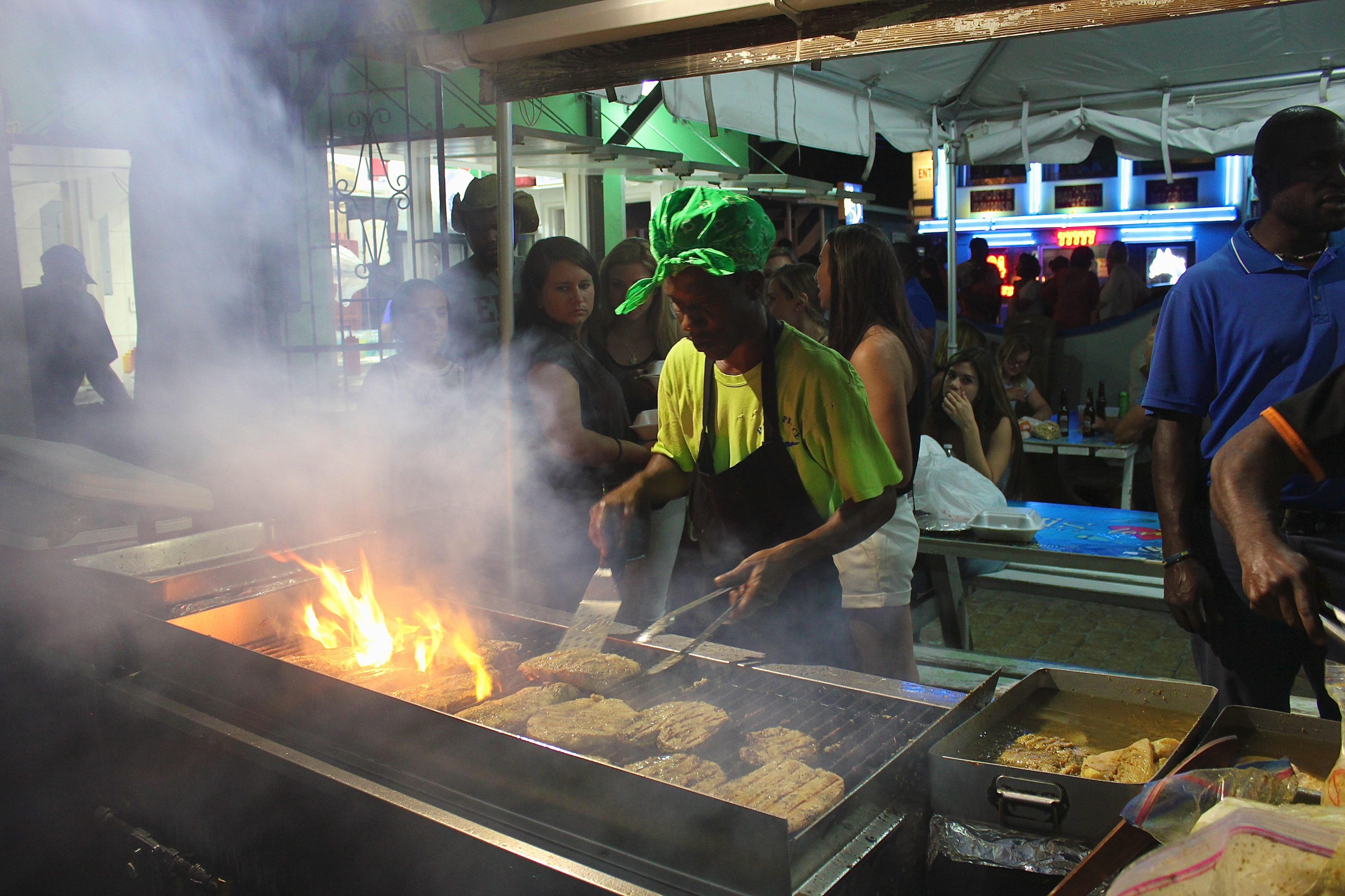 A Bajan cook fires up fish at the popular Oistins stand, Pats Place. Photo by Kimberley Johnson, Ottawa Magazine.