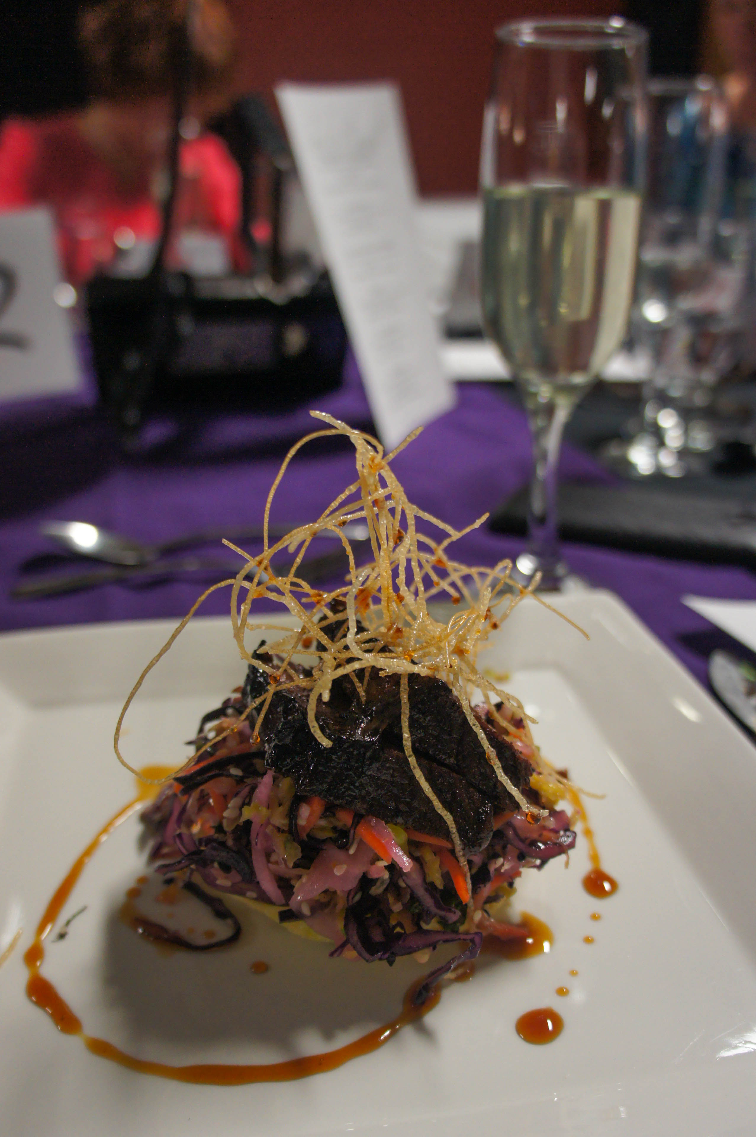 The 1990s were represented by this plate, prepared by Chef Chris Lord and students: beef shortrib, Asian slaw and scallion pancake. Photo by Katie Shapiro, Ottawa Magazine.