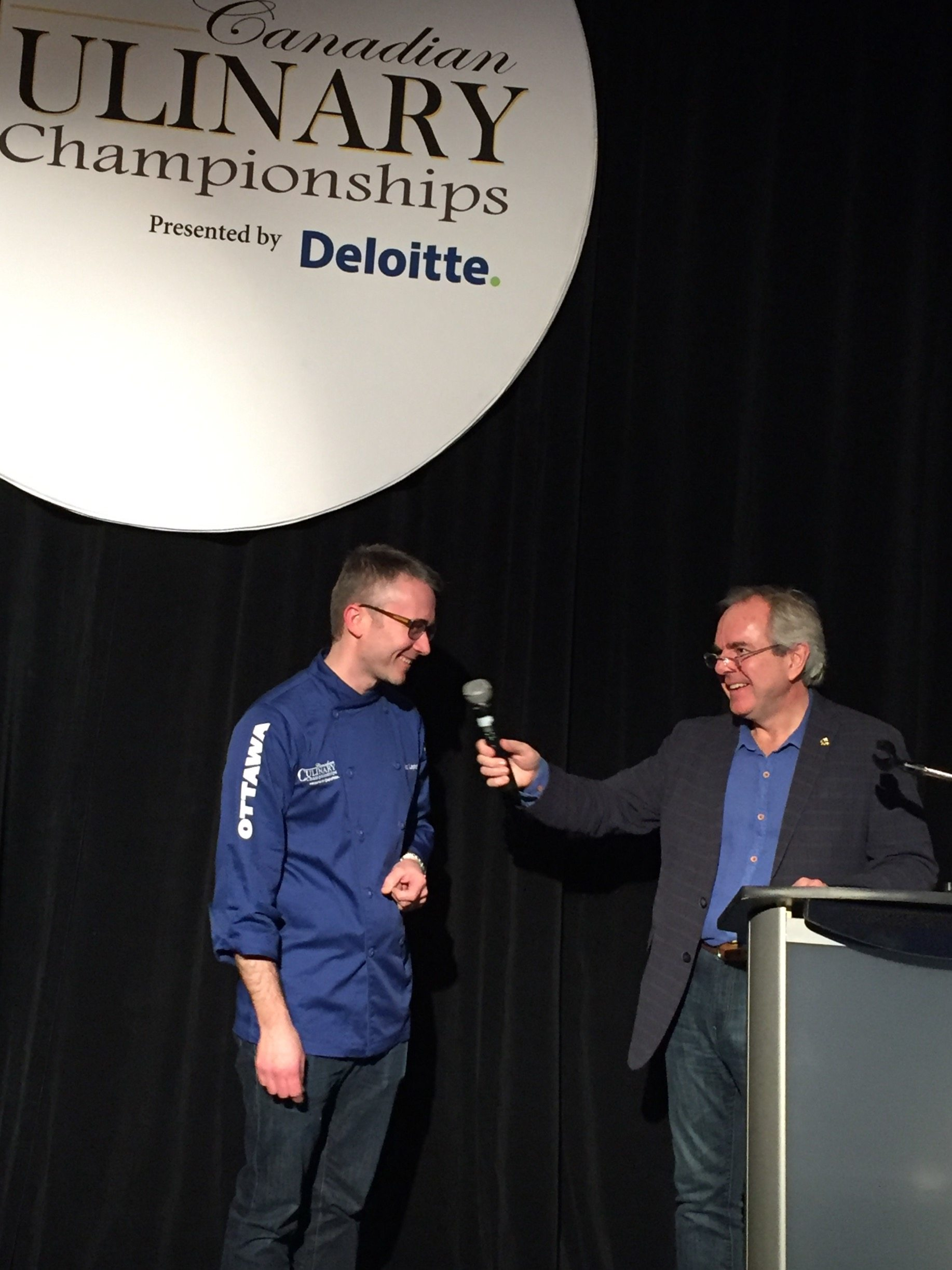 "James Chatto, head judge, introduces Marc Lepine. ""Wow, what a weekend,"" said Chatto. ""This was an amazing culinary triathlon and every dish was a champion in its own city and a potential champion here."" Photo by Anne DesBrisay, Ottawa Magazine."
