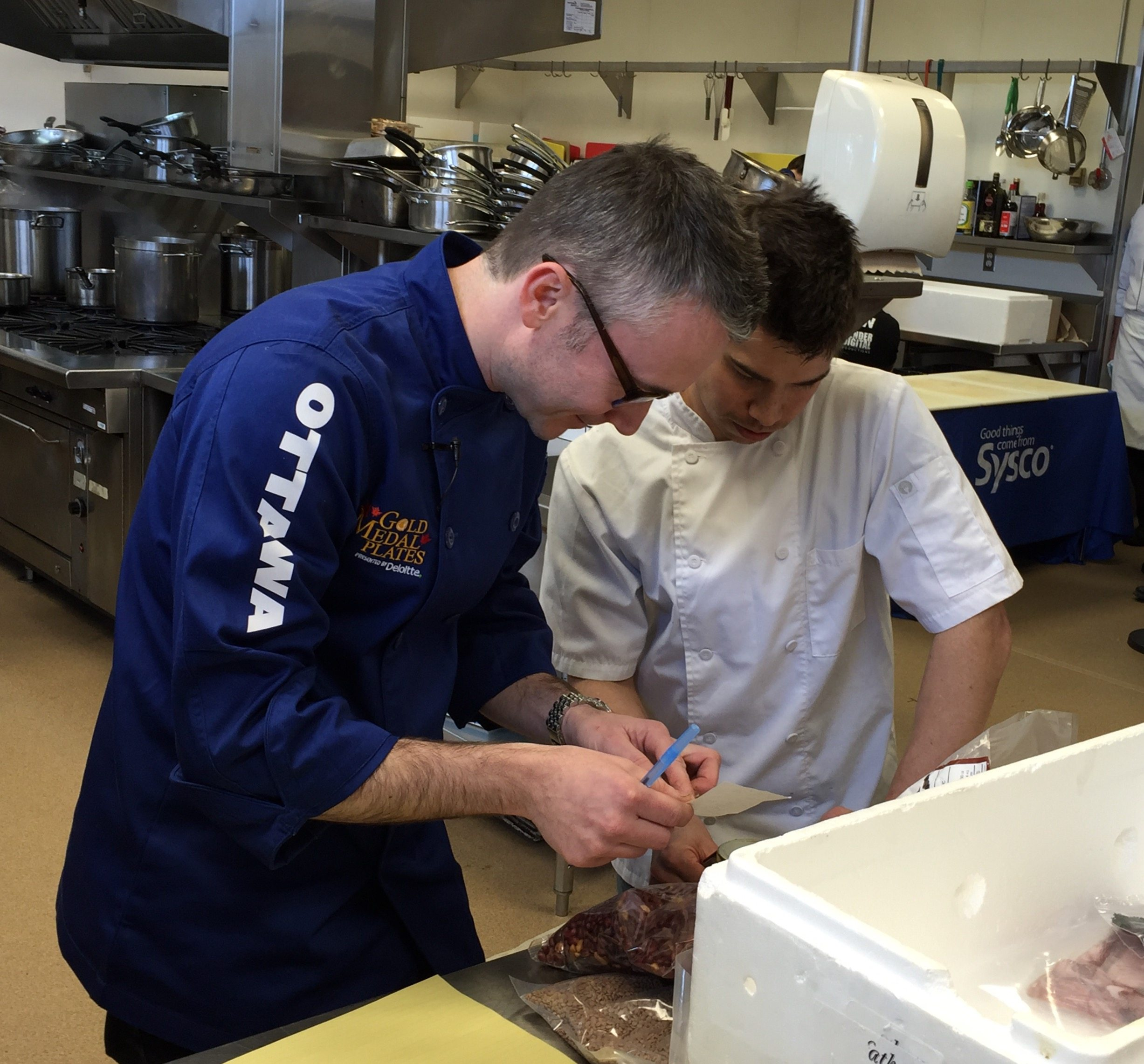 "Marc Lepine and sous-chef Jason Sawision get to work on their plate for the ""black box"" portion of the competition. Photo by Anne DesBrisay, Ottawa Magazine."