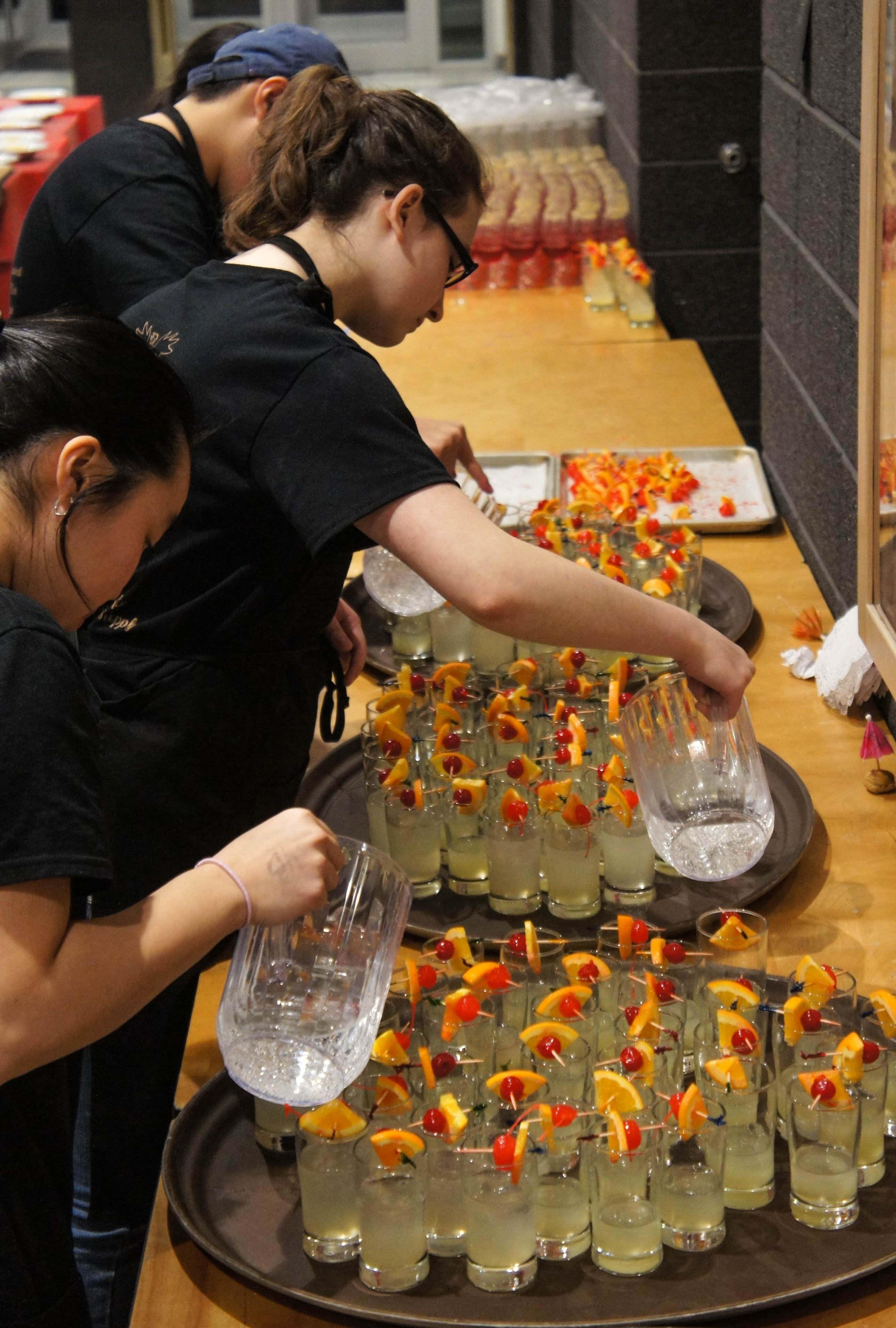 Students get busy preparing mocktails for guests. Photo by Katie Shapiro, Ottawa Magazine.