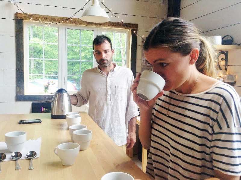 Luc Alary and Kerri Flanagan demonstrate a coffee cupping, in which they analyze the tastes and aromas of a sample batch of roasted beans.