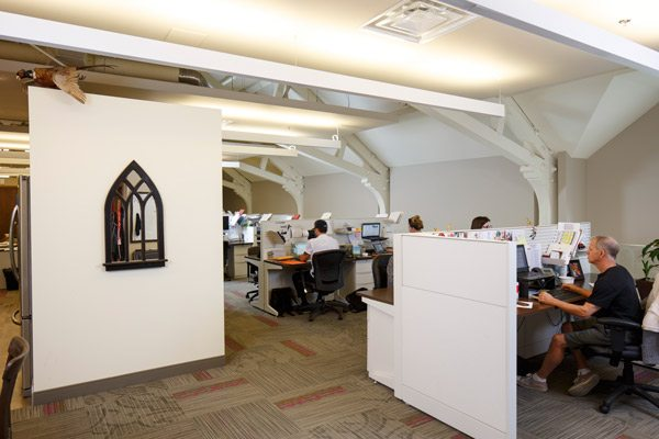 Because the church had soaring ceilings, architect Barry Hobin could put in a second floor under the roof. This is where Bluefest staff work. It is more of a mezzanine, with glass railings all around and views down to the first floor. Photo by Miv Fournier