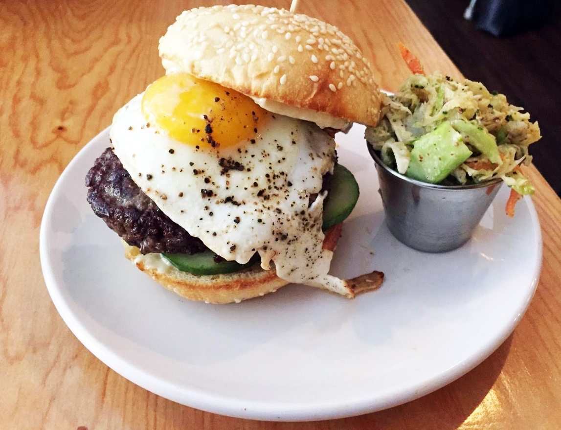 Clover's burgers are loosely-packed, house-ground, grass-fed beef, tucked in a soft sesame bun and topped with the day's inspiration