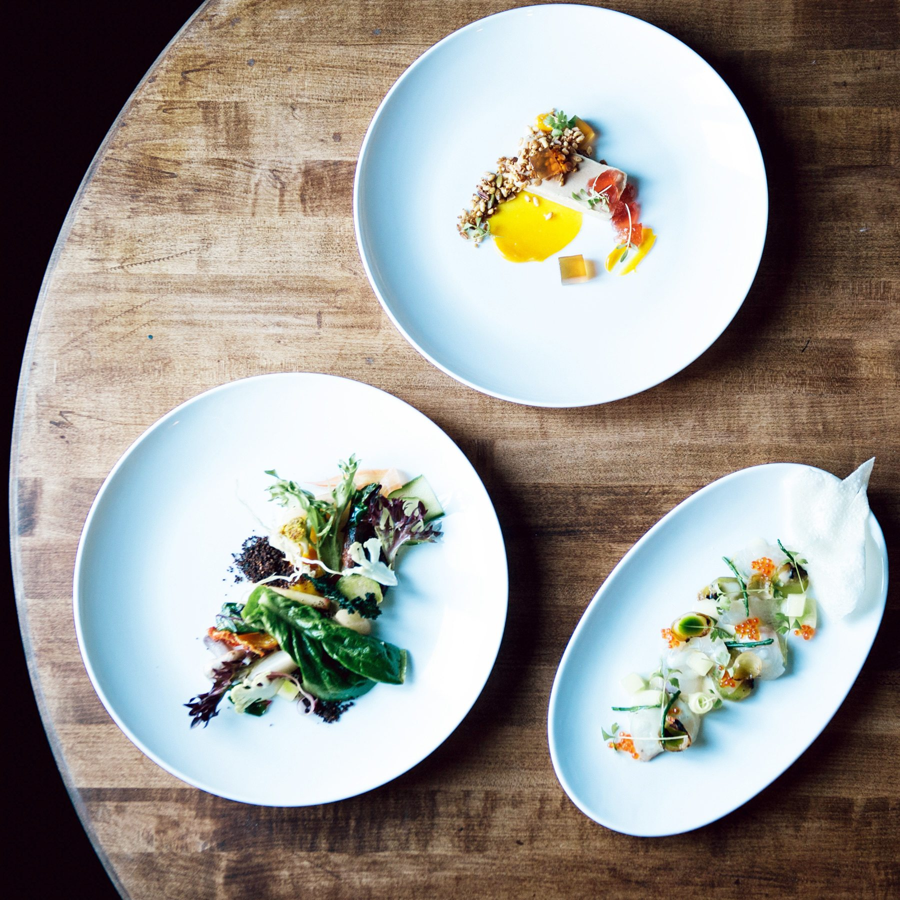 A selection of dishes from the menu includes foie gras, an inventive winter salad, and sea bream crudo. Photo: Frazer Nagy of Transparent Kitchen