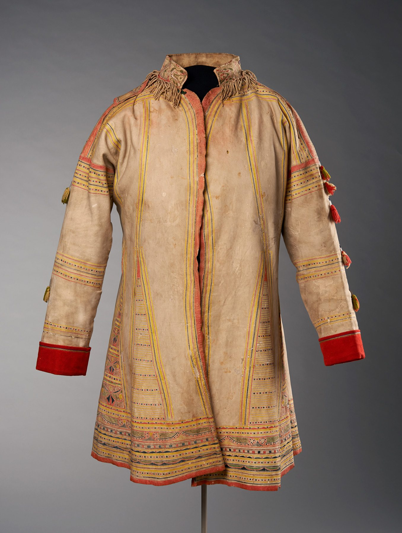 Unknown (Naskapi Artist) Hunting Coat, c. 1840 caribou hide, paint, thread, wool and glass beads, overall measurements on mannequin: 95 x 80 x 50 cm Purchased 2014 National Gallery of Canada, Ottawa Photo: NGC
