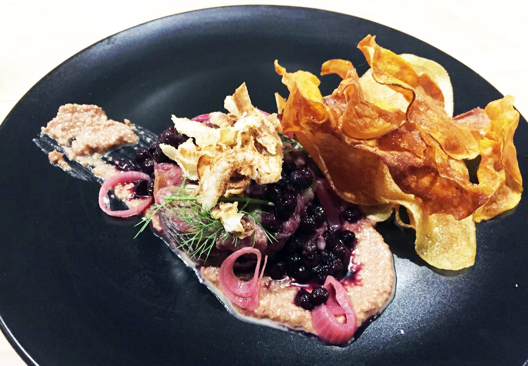 A full flavoured venison tartare with a yogurt whip, sweetened with date and nubbly with walnut