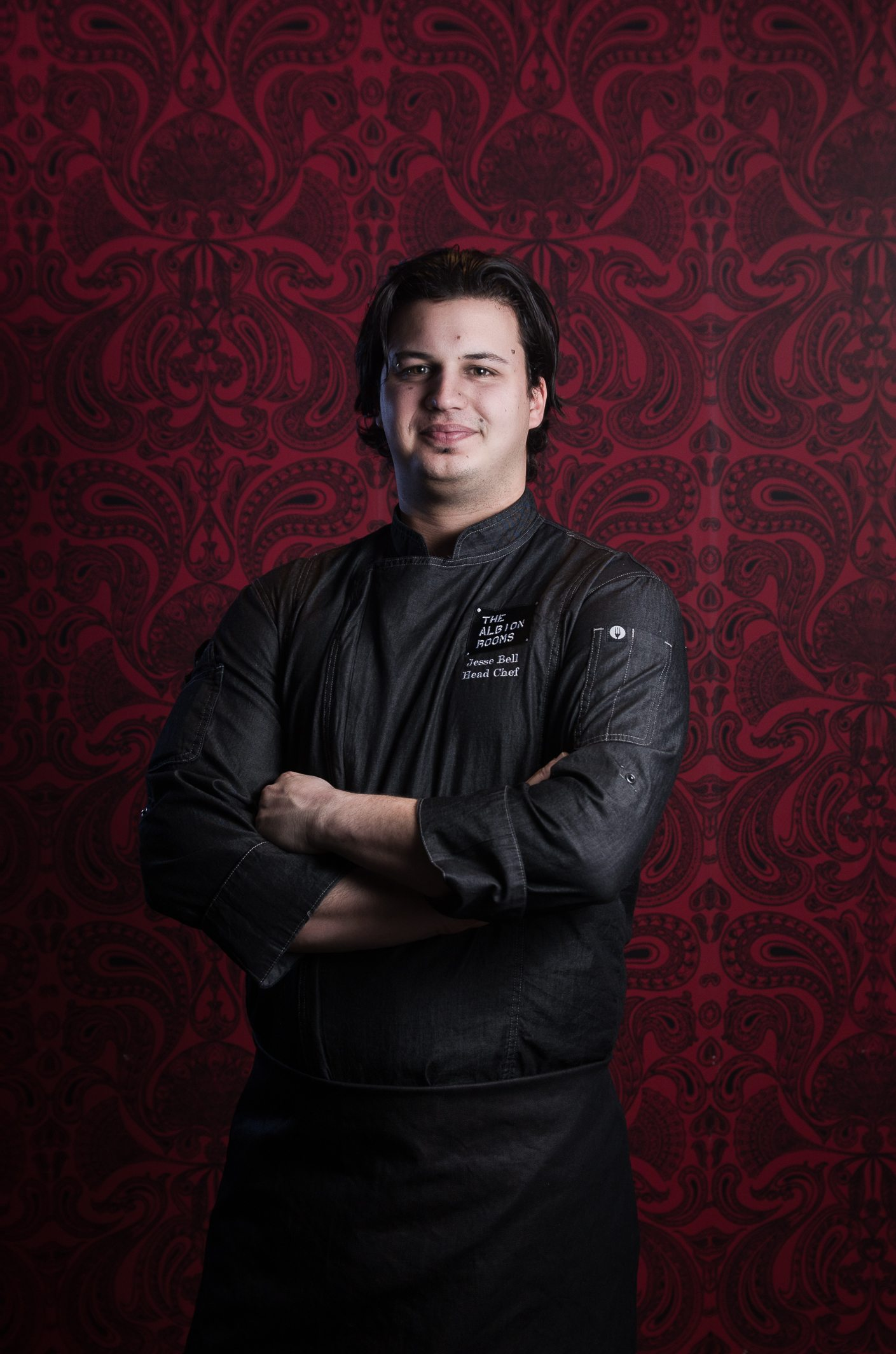 Executive Chef Jesse Bell stands in front of the rich wallpaper in The Heritage Room Gastropub. Photo: Shane Francescut