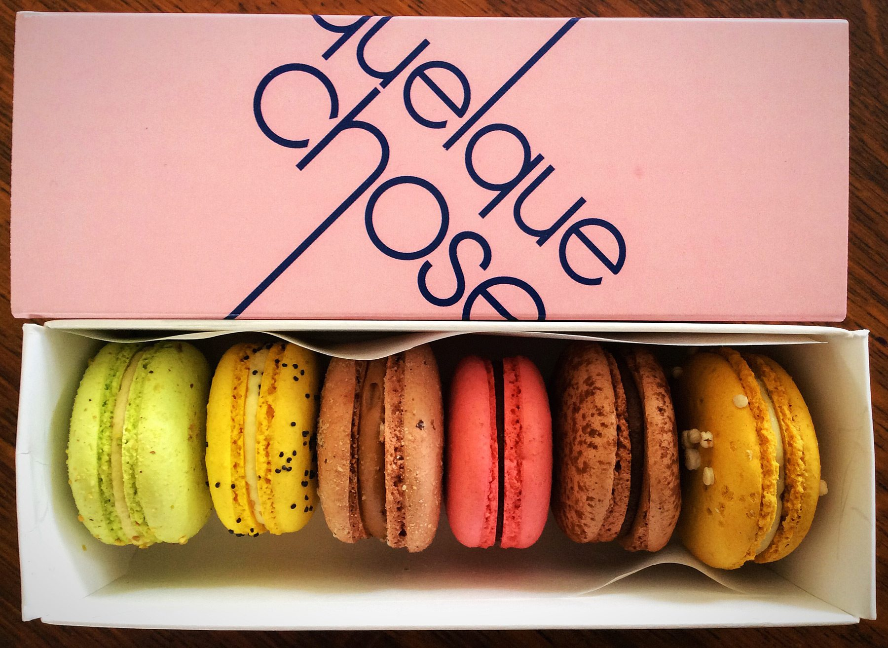 A box of macarons comes with a picture guide so you can remember what you've ordered. This selection includes pistachio, lemon-poppyseed, and raspberry-chocolate
