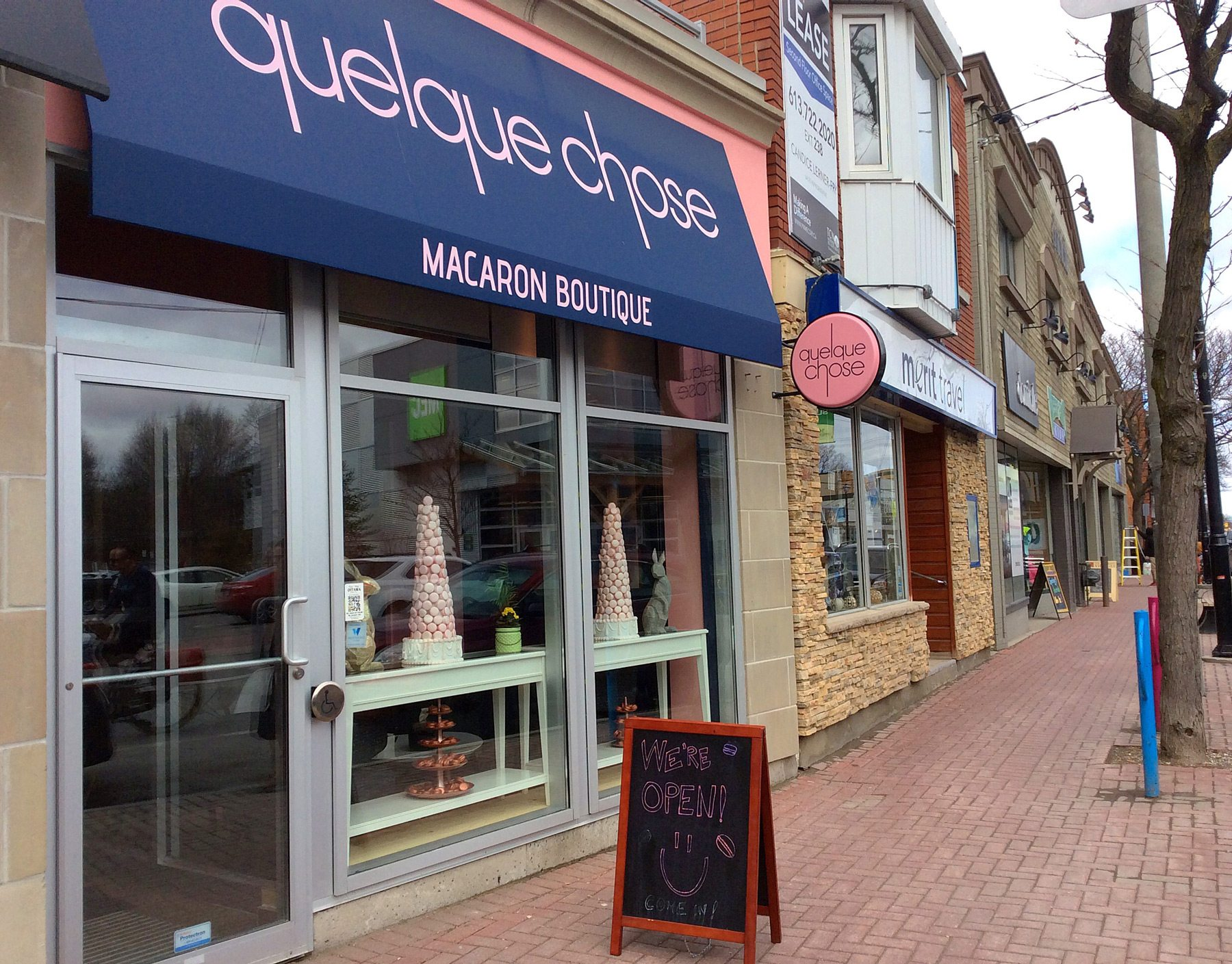 The store, located directly across Richmond Road from MEC, attracts passersby with macarons towers in the window