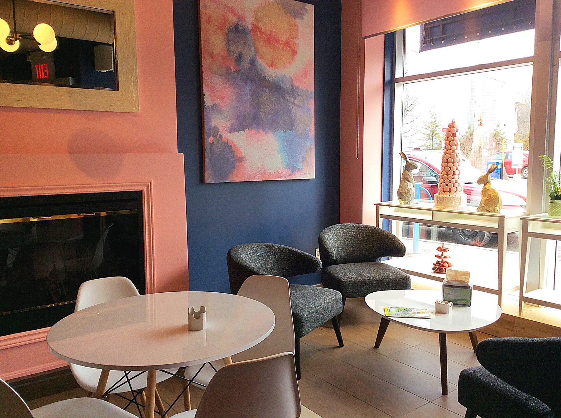 The coffee shop is bright and sunny with a pink and blue motif. In summer, the owners will open a rooftop terrace