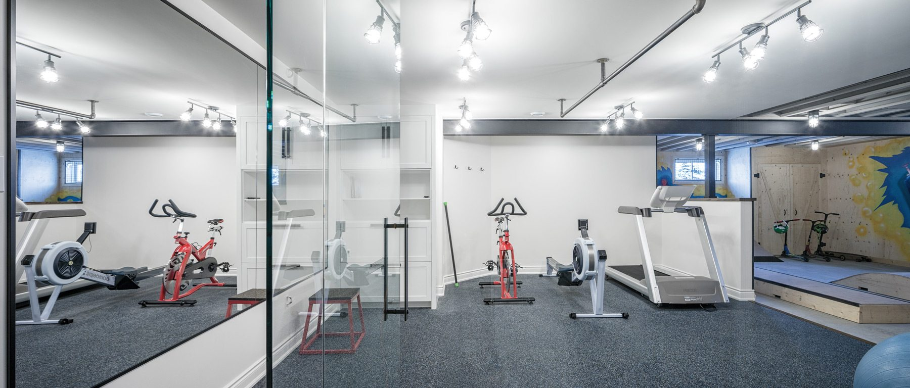 The scooter space is open to the home gym. Photo: Justin Van Leeuwen
