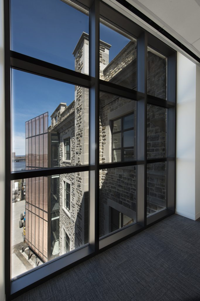 The new glass facade, seen from the inside, . Photo by Marc Fowler