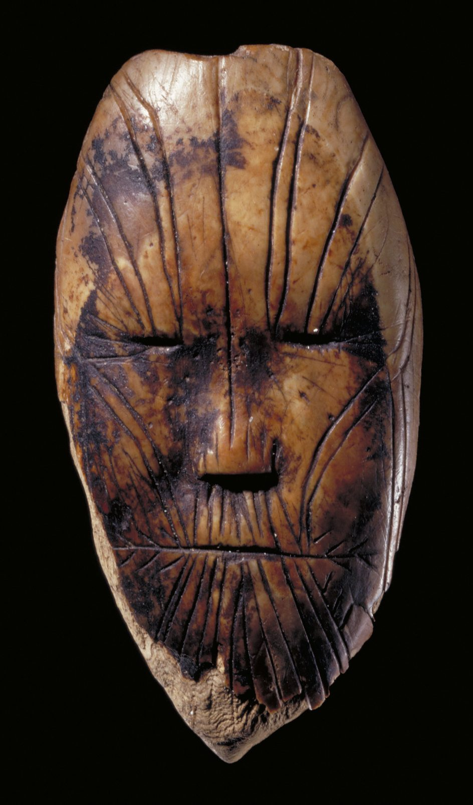 An ivory carving between 3,900 and 3,600 years old — the oldest known depiction of a human face in Canada. Canadian Museum of History