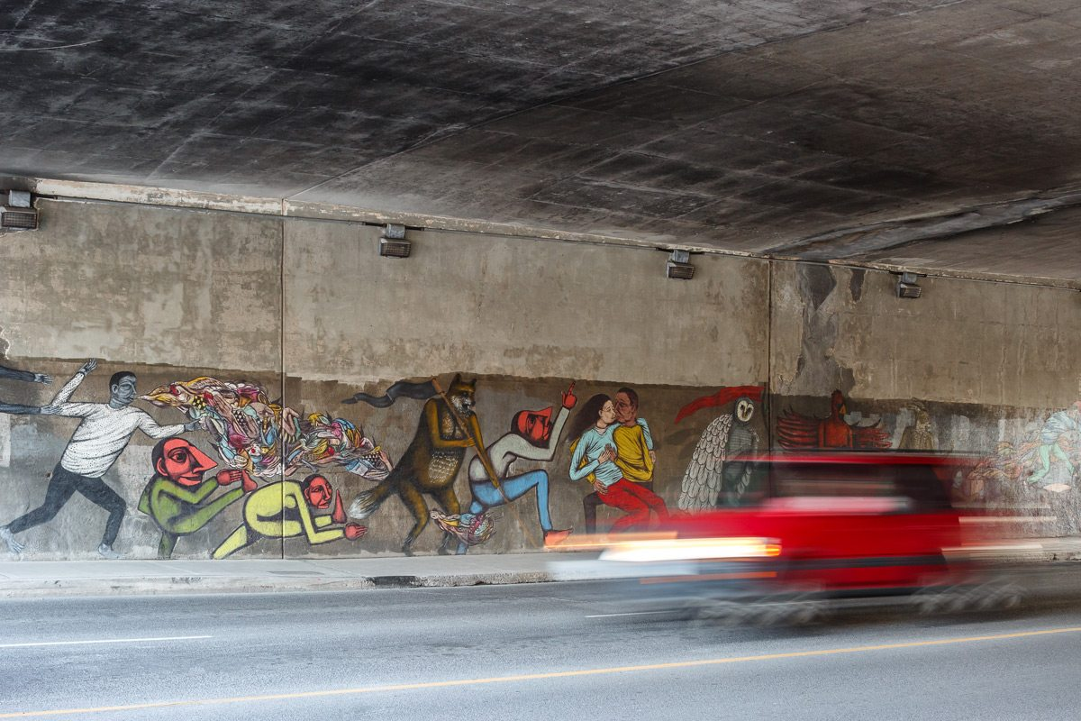 Heart of a City in Motion, painted by Drew Mosley, Felix Berube, and Troy Lovegates. On Bank street, under the Queensway. Photo: Doublespace Photography