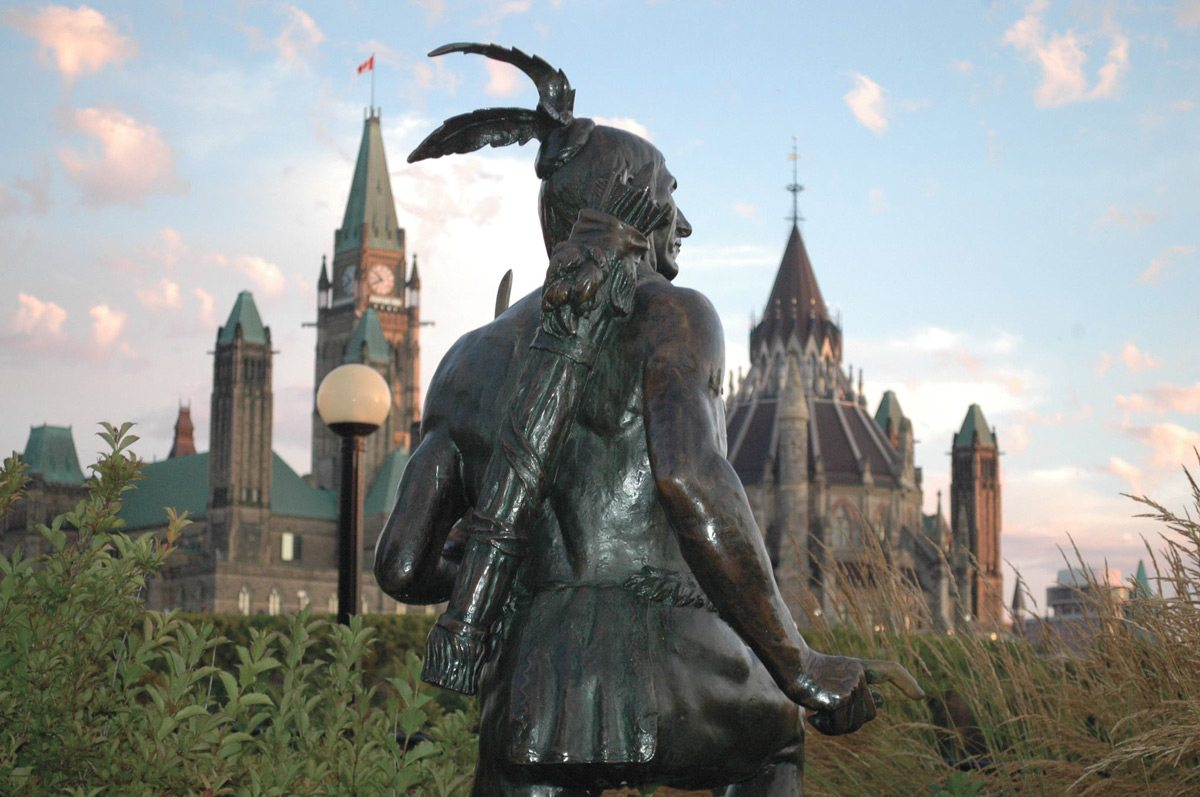 Anishinabe Scout, by Jeff Thomas, used to be located, subserviently, at the feet of the Champlain sculpture at Nepean Point. Photo: Howard Adler