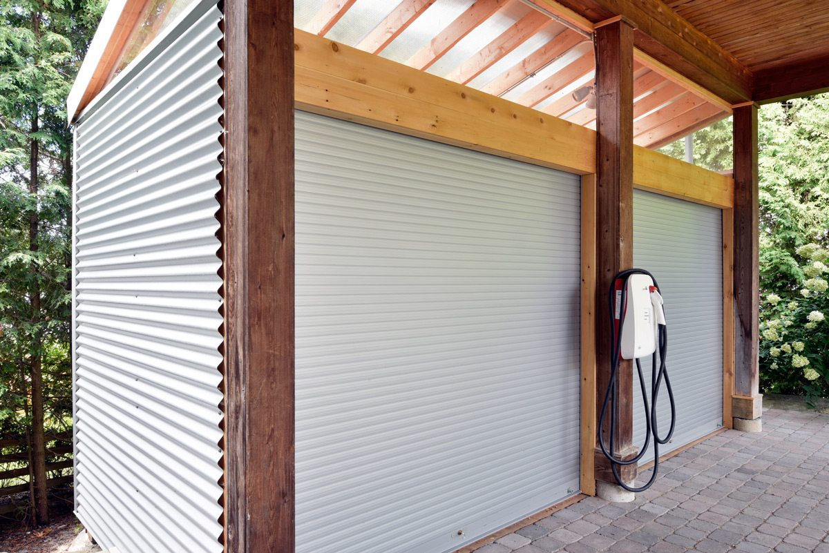 When architect Isabelle Bradbury decided to make cyclists the cornerstone of her vacation rental business, she knew a bike shed was a must-have. The huge roll-up doors make it easy for cyclists to get in and out, while the wall hooks boost storage capacity. A car-charging station looks to a future when electric cars will rule the roads. Photo: Gordon King